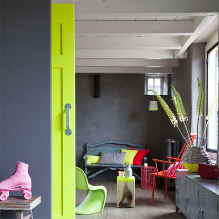 Brighten up a drab hall or passageway by painting doors and trim in vivid fluorescent hues
