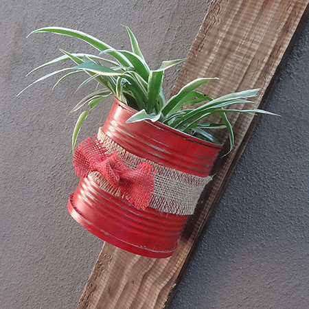 Recycled can plant holder with reclaimed wood