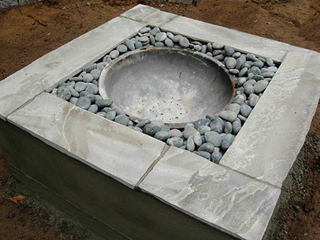 Make a concrete firepit for winter evenings outdoors