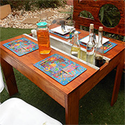 Garden table with channel for condiments or herbs