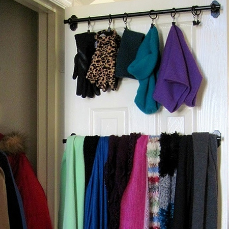 use poles and brackets on back of closet door for space saving ideas