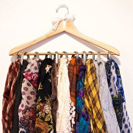 curtain rings on coat hanger for scarf rack for space saving closet ideas
