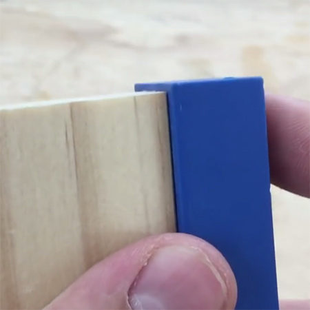 1. To make your own pockethole plugs you will need a pockethole jig, pockethole drill bit and a clamp, as well as an offcut of the wood you will be using for your project. Place the drill bit into the jig and line up as close as possible with the end of the jig.