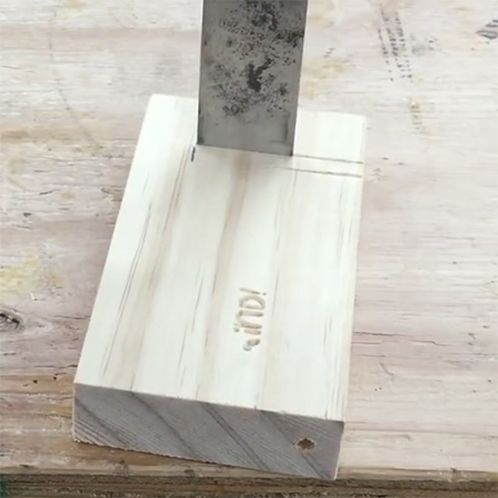 4. Use a wood chisel to chase out a slot in the block of wood. This should be approximately 5mm wide by 45mm in length.