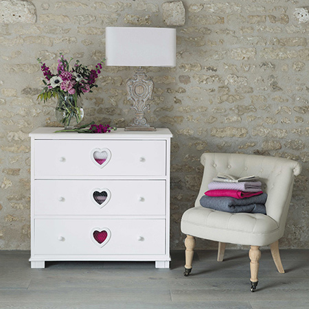 chest of drawers with heart cut out and distressed finish