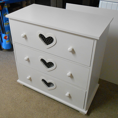 make chest of drawers with heart cut out and distressed finish