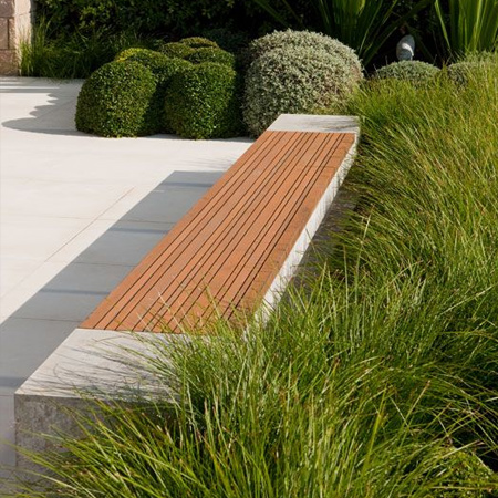 incorporate freestanding or built-in benches, and design a bench that complements any garden design