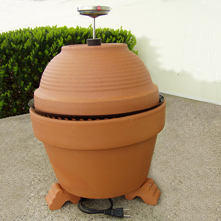 A store bought smoker can cost a small fortune, but you can make your own smoker with a few supplies and a couple of terracotta pots.