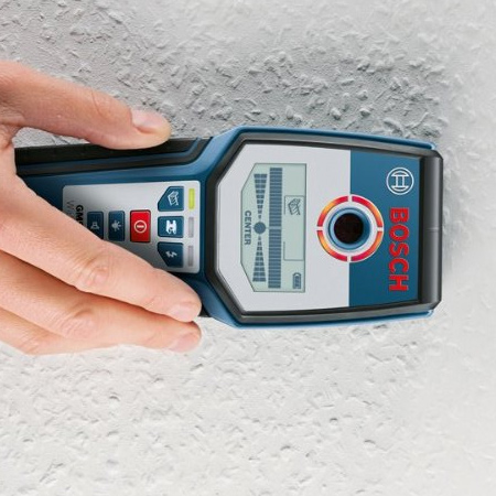Before drilling any holes in solid ceilings, use an electronic detector to determine the positioning of conduits or electrical wires