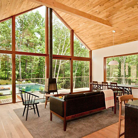 Naturally modern wood homes with wood clad ceilings and wood plank floors