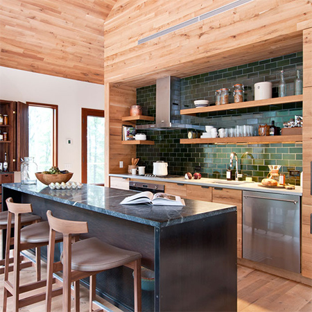 Naturally modern wood homes with wood wall cladding in kitchen