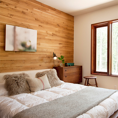 Naturally modern wood homes timber plank wall in bedroom