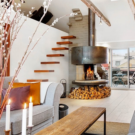 Attic  or loft  conversion becomes spacious living space fireplace