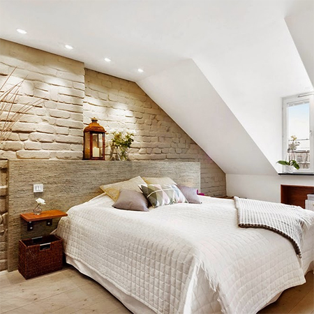 Attic conversion becomes spacious living space bedroom