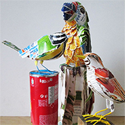 Recycled cardboard bird figurines