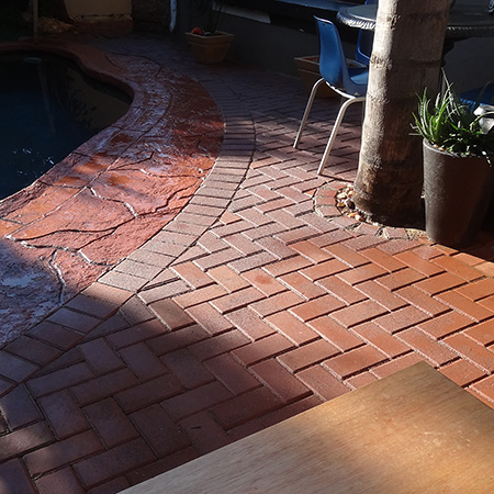 laying cement brick flooring for outdoor entertainment area