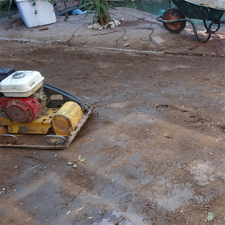 compacting ground before laying concrete paving bricks