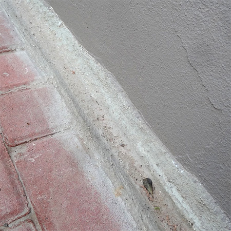 drainage gutter along edge of paving for water run off