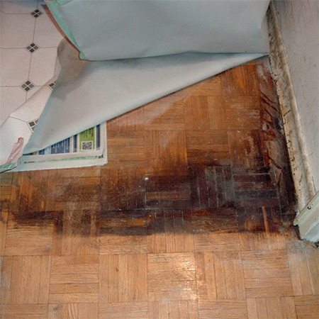 parquet floor under vinyl laminate badly stained