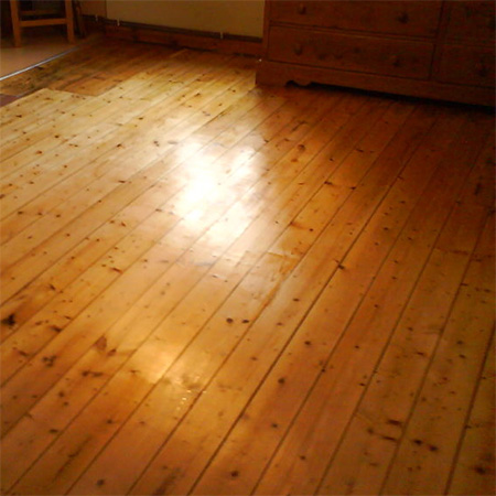Oregon pine  								floor after sanding and application of matt  								floor sealer.