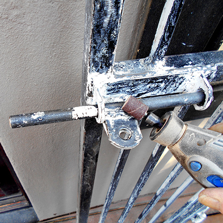 dremel rotary multitool to remove paint on security gates and burglar bars