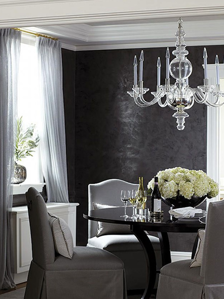 Polished black Venetian plaster is the perfect finishing touch for this formal dining room