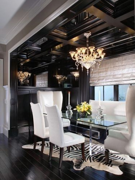The black vaulted ceiling and cabinetry provide a dramatic backdrop for this modern dining room