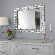 Knock-off designer metallic mirror frame