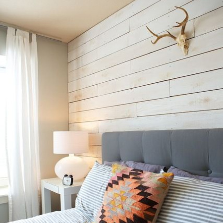 DIY plank wall in a bedroom painted white