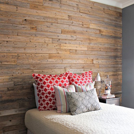 DIY reclaimed timber plank wall in a bedroom