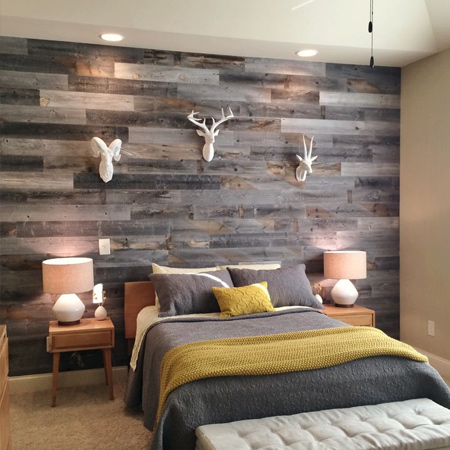 DIY reclaimed wood or timber plank wall in a bedroom