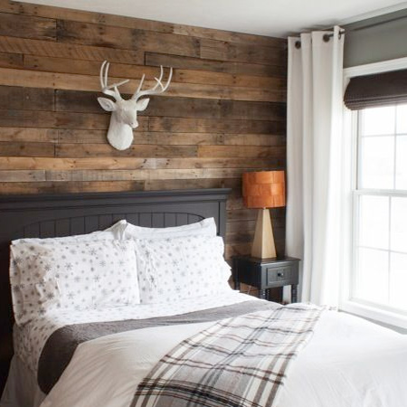 DIY plank wall in a rustic bedroom