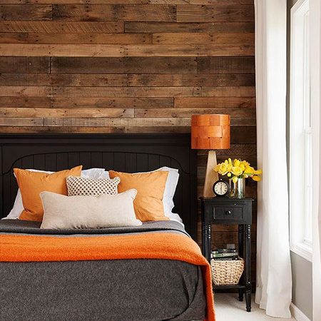 DIY reclaimed wood plank wall in a bedroom