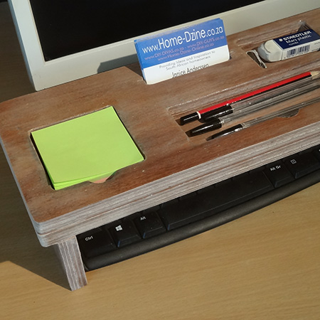 storage holder that fits over a keypad for pens and pencils, notepad and cellphone