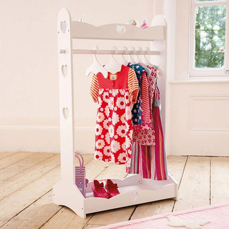 Clothing rail with heart cut outs for little girls bedroom