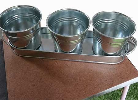 Rust-Oleum Universal Aged Copper was used on these inexpensive galvanised zinc flower pots to give them a vintage finish