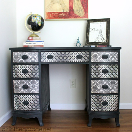 chest of drawers is transformed using paint, scrapbook paper and ModPodge