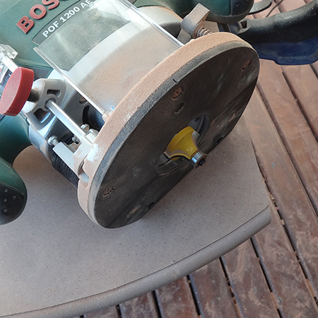 bosch router with tork craft roundover bit for edge of table top