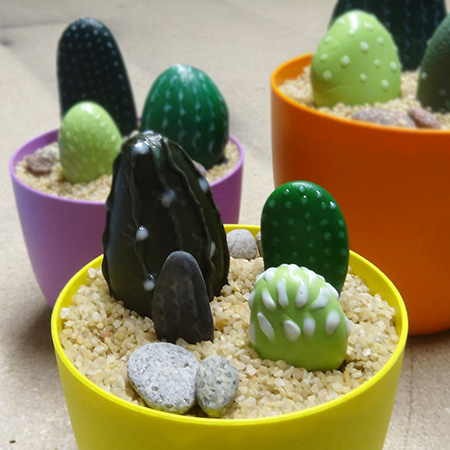 Paint pebbles for colourful cacti display