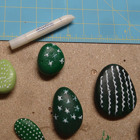 Painted pebbles for colourful cacti display