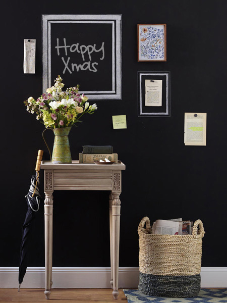 Chalkboard paint continues to feature in homes as a way to create a practical feature wall. A matt black wall lets accent furniture stand out