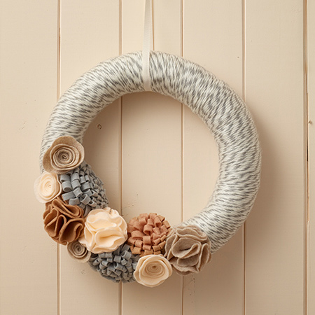 Use affordable felt to make unique holiday decor for the festive season. In this feature we show you how to make a felt wreath and felt garland.