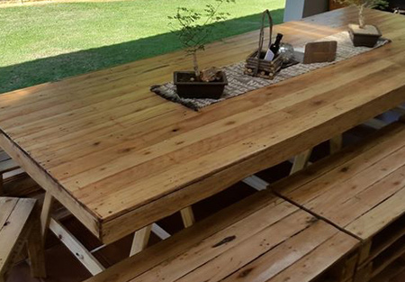 For the larger family, this reclaimed pallet dining table has both benches and chairs, allowing comforable seating for up to 14 people.