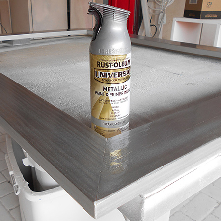 Wipe clean to remove any dust before spraying the entire frame with Rust-Oleum Universal spray paint