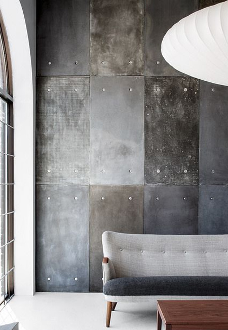 Make your own concrete-effect feature wall using cement fibre board with plaster and paint finish techniques