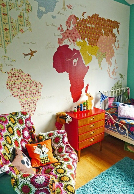 Wall maps have been trending for a couple of years now, and you can make your own feature wall map using paint and wallpaper or scrapbook papers.