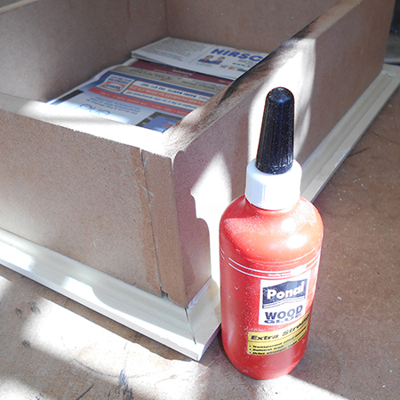 9. Use pieces of newspaper to cover the glass inside and on top to protect when painting with spray paint.