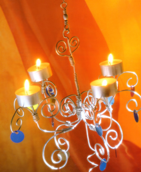 Home dzine craft ideas decorative wire chandelier crafted from wire this delicate chandelier was twisted and curled into shape and making it is so much fun that you will want to make more aloadofball Choice Image