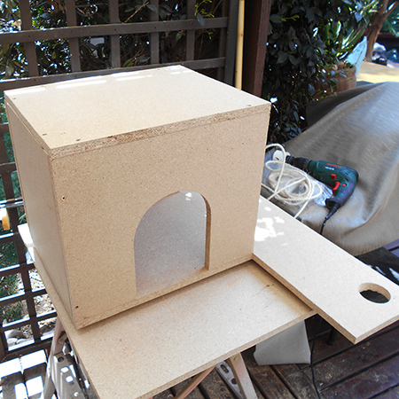 5. Assemble the box by securing the front and back onto the platform from underneath; insert the one side section and secure through the base and also through the front and back sections. Attach the top.