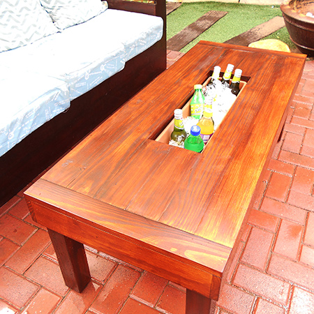 This outdoor table has a built-in ice cooler to keep all your summer refreshments cold on hot, hot days.
